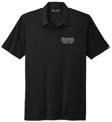 A black TravisMathew Oceanside Solid Sport Shirt Shown with a white embroidered left chest business logo.